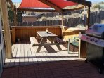 Rear deck with picnic table and BBQ grill. All you need are the ice cold beers and the burgers!