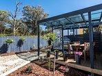 The outdoor undercover BBQ area is a gorgeous space and has dining setting for outdoor eating