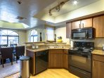 Fully equipped kitchen with granite counters