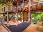Hear the ducks quacking in the fish pond whilst sitting on the wooden swing or laying on the hammock