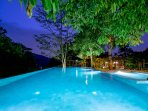 Grab your favorite drink and gather by the outdoor pool and jacuzzi at night.