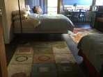 Showing queen bed and partial twin on right in suite