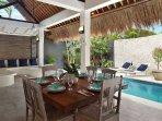 Outdoor breakfast area overlooking private pool