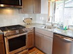Fully equipped kitchen with stainless steel appliances, gas cook stove, granite counter tops and ocean views