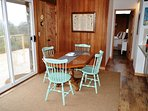 Dining are for 4 with two extra chairs, a slider leading out to deck and ocean views