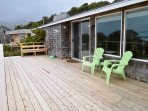 Large ocean facing deck with patio chairs, built-in bench and beautiful view of the ocean and Neahkahnie Mountain