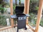 Glassed in BBQ area with a gas BBQ and ocean views