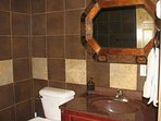 Lower level Fully-tiled bathroom with heated floors and walk-in rain shower.