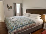 Bedroom with King bed, ensuite, mirror wardrobe & desk (air conditioned & ceiling fan).