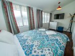 Bedroom with Queen bed, Chest of Drawers, TV & DVD player (air conditioned).