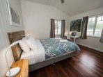 Bedroom with Queen bed, small ensuite, mirror wardrobe & desk (air conditioned & ceiling fan).