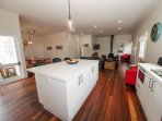 From the open plan kitchen you have access to the verandah with outdoor dining and BBQ.