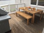 Verandah with outdoor dining and modern BBQ.