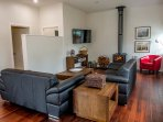 The living area with leather sofas, fireplace (seasonal), TV & DVD player and extensive DVD library.