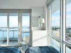 The floor to ceiling guest bedroom windows look onto the bay