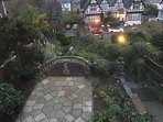 View of the terraced front garden at dusk.