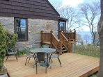 Outdoor space includes two decks and a view.