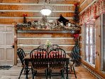The cabin is decorated in a rustic bear theme.
