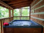 Relax in the hot tub after a great day in the Smokies on the large covered deck.