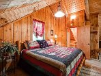 Upstairs features king bed with new bedding, new carpet, and open to lower level