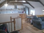 Kitchen/living area, new oak wood floor and original beams and stonework.