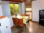 Dining area, TV, refrigerator