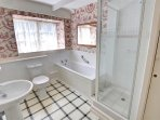 The spacious bathroom has a separate shower cubicle