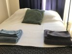 Queen size bed, firm, comfortably sleeps 2 adults