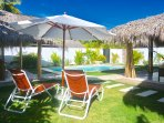 A large garden equipped with lounge chairs will make you wonder, 'why go anywhere else?'