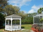 Gazebo with table and chairs.