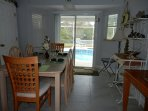 Fully furnished Kitchen and dining area with view of pool and lake.