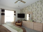 Large master bedroom with LCD TV (cable and UK TV)