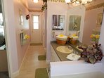 Master en suite bathroom with garden tub with access to pool area.