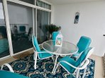 Ocean Front balcony with picnic table and chaise lounge