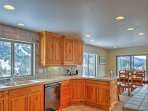 The chef of the group will relish in the fully-equipped kitchen where they'll cook on tile countertops in the company...