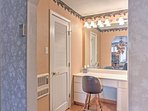 Primp for a night on the town using the master suite vanity.