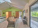 Enjoy a tropical getaway at this 2-bedroom, 2-bathroom vacation rental home in Keaau, which sleeps 4.