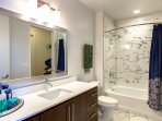 2nd family bathroom - marble tiling , tub and shower combined