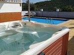 beautiful heated pool and hot tub