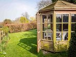 Part of the garden and the summer house is reserved exclusively for Old Manor Cottage guests