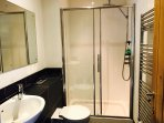 Shower room with extra large shower and heated towel rail