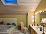 Master Bathroom with very large jacuzzi and walk in shower