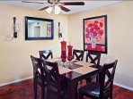 dining room connected to living room with 6 chairs