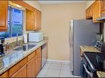kitchen with the appliances and coffee maker, toaster etc.