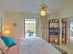 The master bedroom features a king bed, ensuite bathroom, and access to the private backyard.