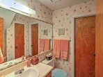 Freshen up upstairs in the half bathroom after an active day outdoors.
