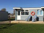 Sandy Shores is an end terrace, south-facing chalet, with its own patio leading to grassed area
