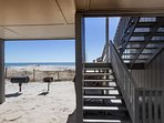 The beach and a barbecue grill are right down the stairs from your balcony.