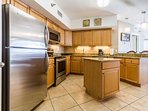 Gorgeous kitchen with stainless steel appliances & granite countertops.