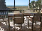Eight person, counter height table and chairs on the lanai.